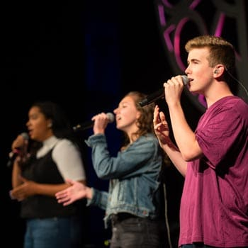 Wheaton Academy students worship in chapel