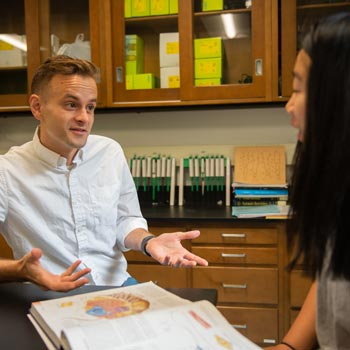 student studies science at Wheaton Academy