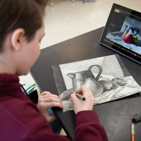 student sketching at Wheaton Academy