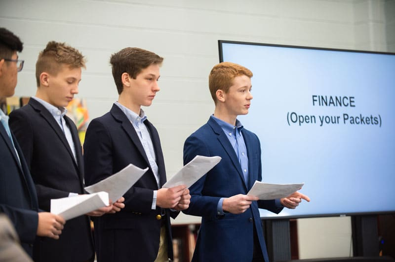 Business students present their plan to investors at Wheaton Academy