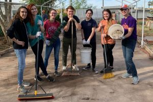 High school students work on service project