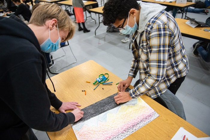 Students draw backdrops for their stop motion short films