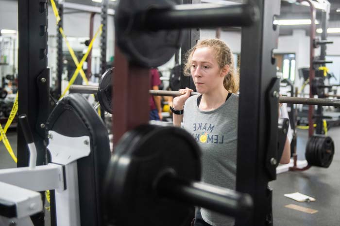 Kathryn lifts weights at Wheaton Academy