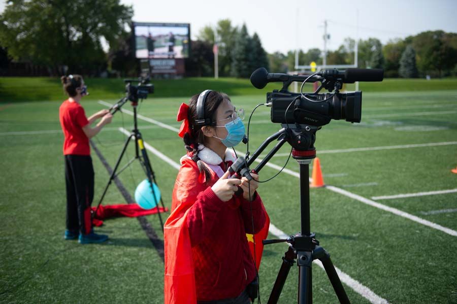 Students livestream outdoor assemblies during in-person learning at Wheaton Academy