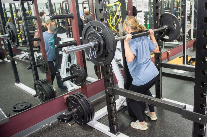Student trains in Wheaton Academy weight room