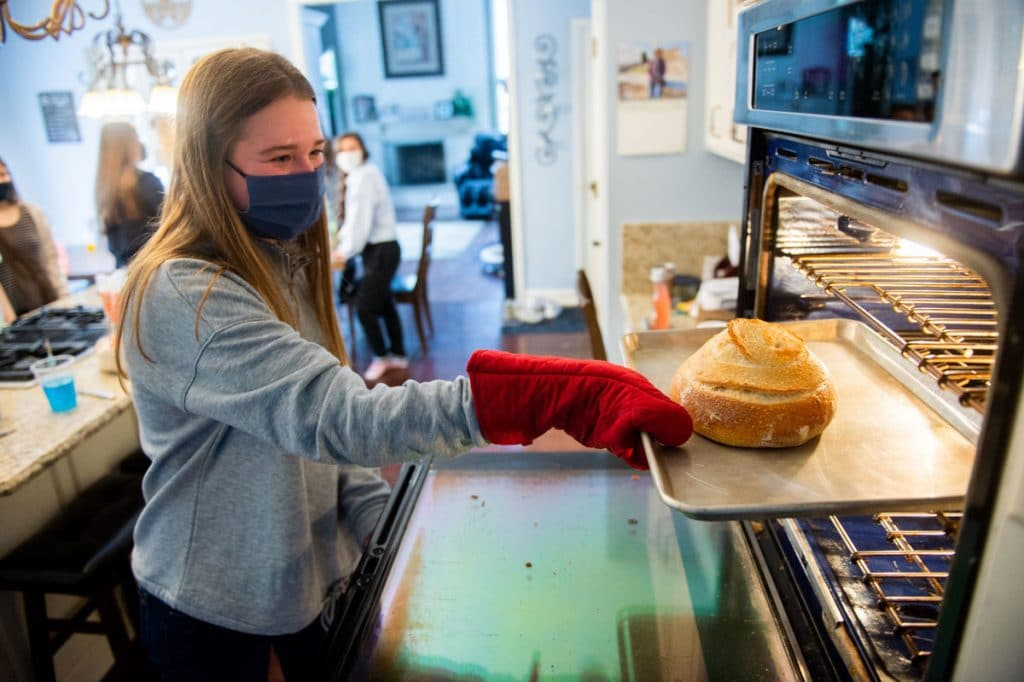 Students bake sourdough loaves during Winterim