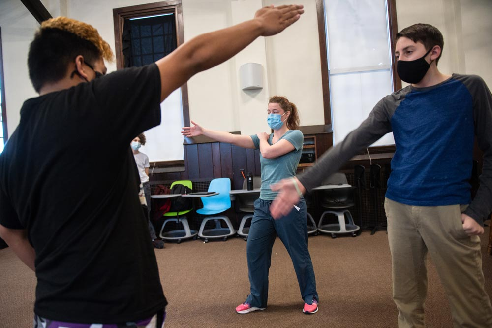 Students learn stage combat during Wheaton Academy Winterim class